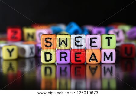 Sweet Dream word with reflection on dice