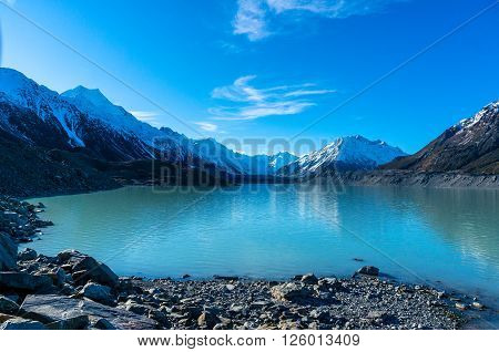 Glacier and lake with turquoise blue water and mountains landscape. Winter mountain landscape with glacier and lake. Tasman glacier Aoraki - Mount Cook National Park New Zealand