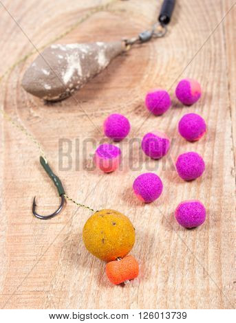 Carp Hook Boilies on wooden background. Close up