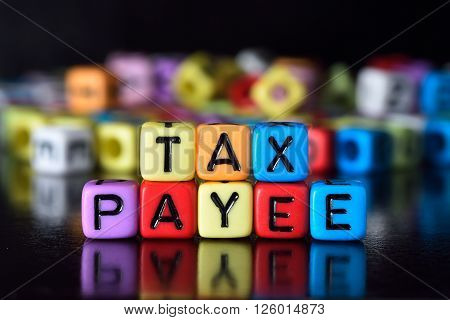 Tax Payee Concept on the table with reflection