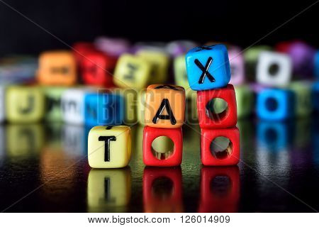 Tax Concept word on stacking red dice