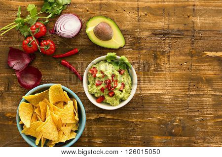 Guacamole with avocado and tomatoes. Mexican food