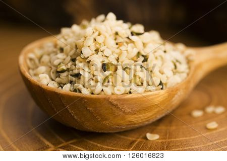 Shelled Hemp Seeds On Wood Background