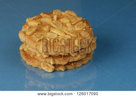 Close-up of peanut butter cookies against a blue background