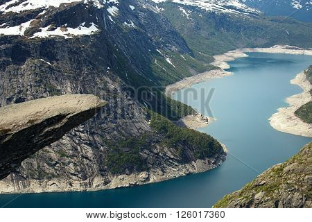 Trolltunga  orTroll's tongue is a piece of rock jutting horizontally out of a mountain about 700 metres, Norway