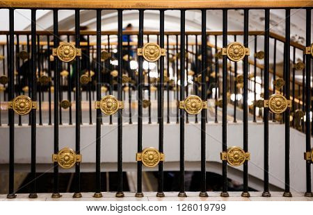 Closeup of fancy handrailing in the Oktyabrskaya subway station in Moscow Russia
