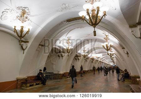 MOSCOW - MARCH 3: People walking in the Arbatskaya metro station on March 3 2016 in Moscow. Arbatskaya was designed by Leonid Polyakov Valentin Pelevin and Yury Zenkevich and build in 1953.