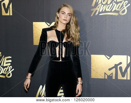 Cara Delevingne at the 2016 MTV Movie Awards held at the Warner Bros. Studios in Burbank, USA on April 9, 2016.
