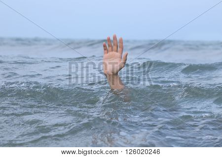 background of hand drowning in the sea