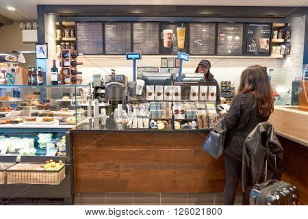 NEW YORK - CIRCA APRIL 2016: people in Starbucks Cafe. Starbucks Corporation is an American global coffee company and coffeehouse chain based in Seattle, Washington