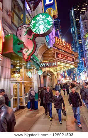 NEW YORK - CIRCA MARCH 2016: Starbucks Cafe at night. Starbucks Corporation is an American global coffee company and coffeehouse chain based in Seattle, Washington