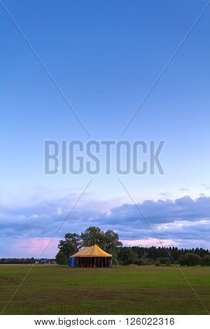 big tent at sunset in nature.  landscape