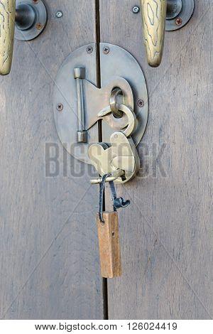 Ancient Brass Lock On Wooden Door