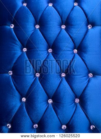 Blue upholstery velveteen decorated with crystals as texture and pattern