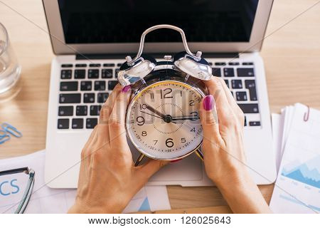 Female Hands Alarm