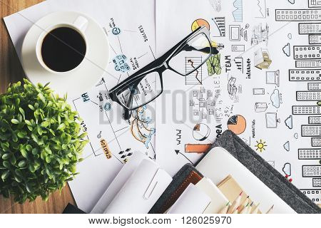 Topview of desk with coffee glasses and plant on business concept sketch