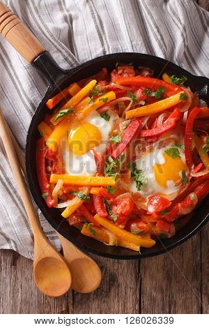 Basque Breakfast: Fried Eggs With Peppers Close-up. Vertical Top View