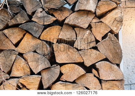 chopped and stacked firewood in the yard.