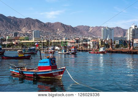 Antofagata Chile April 5 2015 - Colourful wooden fishing boats in the harbour at Antofagasta in the Atacama Region of Chile