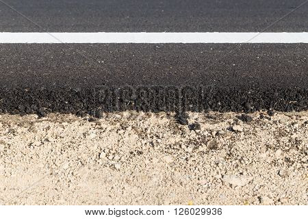 White And Yellow Line On New Asphalt Road