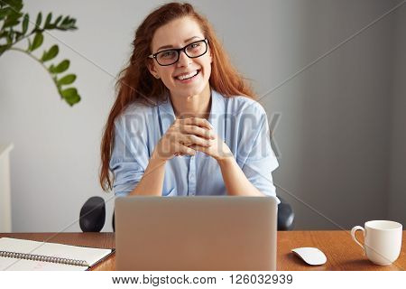 Cheerful Young Businesswoman In Casual Shirt And Glasses Looking And Smiling At The Camera. Happy Su