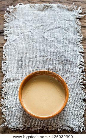 Bowl of tahini sauce close up: top view