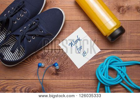 Blue Sport Shoes, Headphones, Skipping Rope, Bottle, Paper Sheet