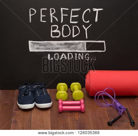 Sport Accessories In Front Of Chalk Desk