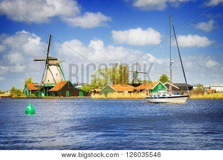 dutch windmills over Zaan river, Holland, retro toned
