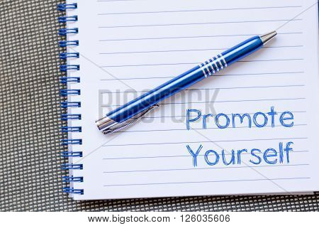 Promote yourself text concept write on notebook