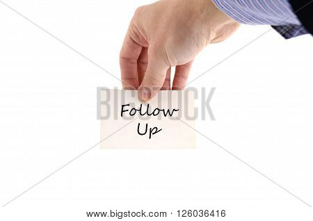 Follow up text note in business man hand
