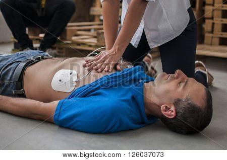 rescuer saving a life making cardiac massage