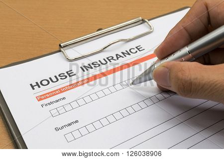 man signing a house insurance policy, rental, contract