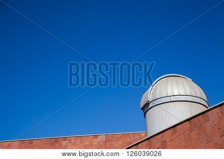 An incredible blue sky over a closed telescope