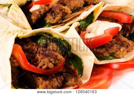 Bunch of gyros pita on rustic background