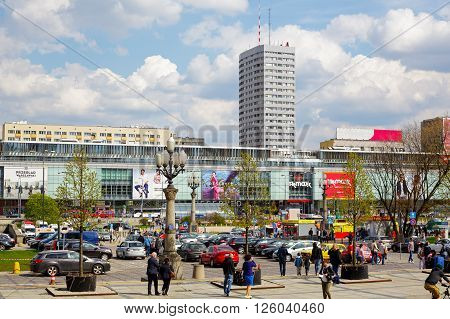 WARSAW POLAND - APRIL 16 2016: The urban complex of buildings along the street Marszalkowska in the downtown built in the years 1962-1969 consists of skyscrapers malls and lower buildings