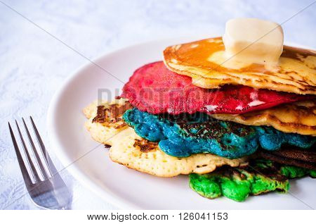 Colorfull homemade pancakes with melted butter on the top