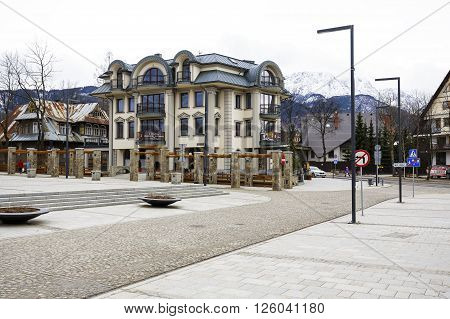 ZAKOPANE POLAND - MARCH 06 2016: A modern apartment block built on the site of a former printing house - Polonia on the ground floor of the building operates fine-dining restaurant since July 2014