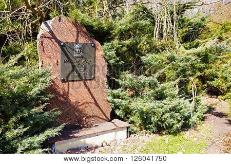 POWSIN POLAND - APRIL 02 2016: Monument commemorates the founder and creator and the first director of the botanical garden in Powsin Professor Boguslaw Molski (1932-1989)