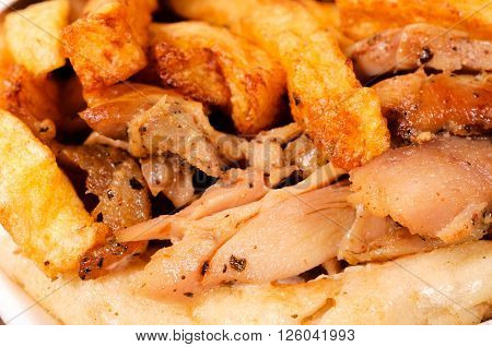 Image of French fries and chicken meat