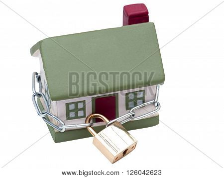 House closed in chain and padlock on isolated white background
