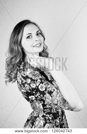 Young happy woman portrait Isolated on white In the beutiful summer dress.