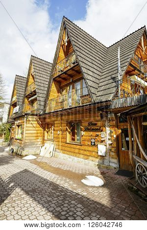 ZAKOPANE POLAND - MARCH 09 2016: Villa Belmont this holiday house offers accommodation for tourists coming to the city. This wooden building refers to the architectural style of the region