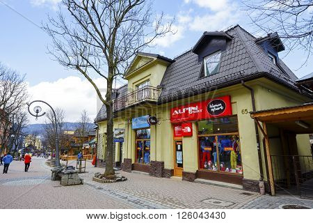 ZAKOPANE POLAND - MARCH 09 2016: Residential and commercial building made of brick plastered built approx. 1925 listed in the municipal register of architectural heritage