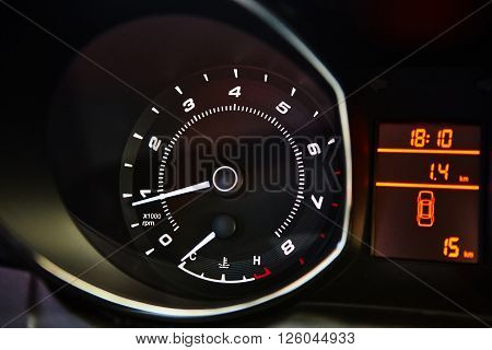 Car Dashboard. Close up image of illuminated car dashboard.