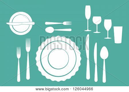 set of dishes, such as plates, forks, spoons and knives