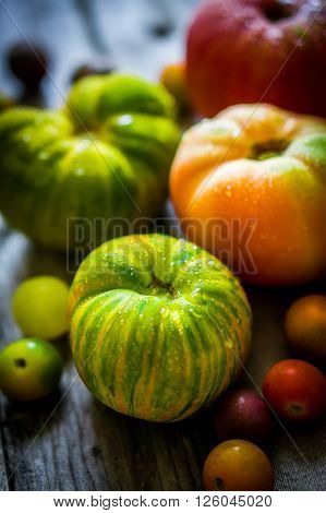 Image of Heirloom Tomatoes On Rustic Background