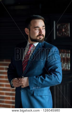 A young bearded businessman monitors external aspects ** Note: Shallow depth of field