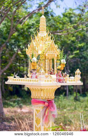 Yellow outdoor spirit house in Thailand, Phuket