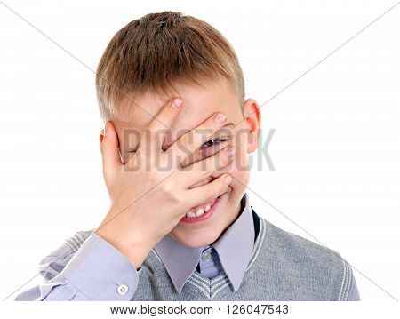 Sly Boy Peeps through his Fingers Isolated on the White Background